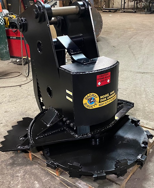 Custom model 1000 disk grinder with hydraulic thumb