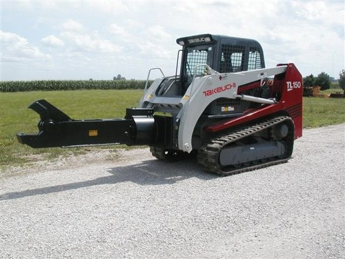 Rotating shear attachment on skid steer