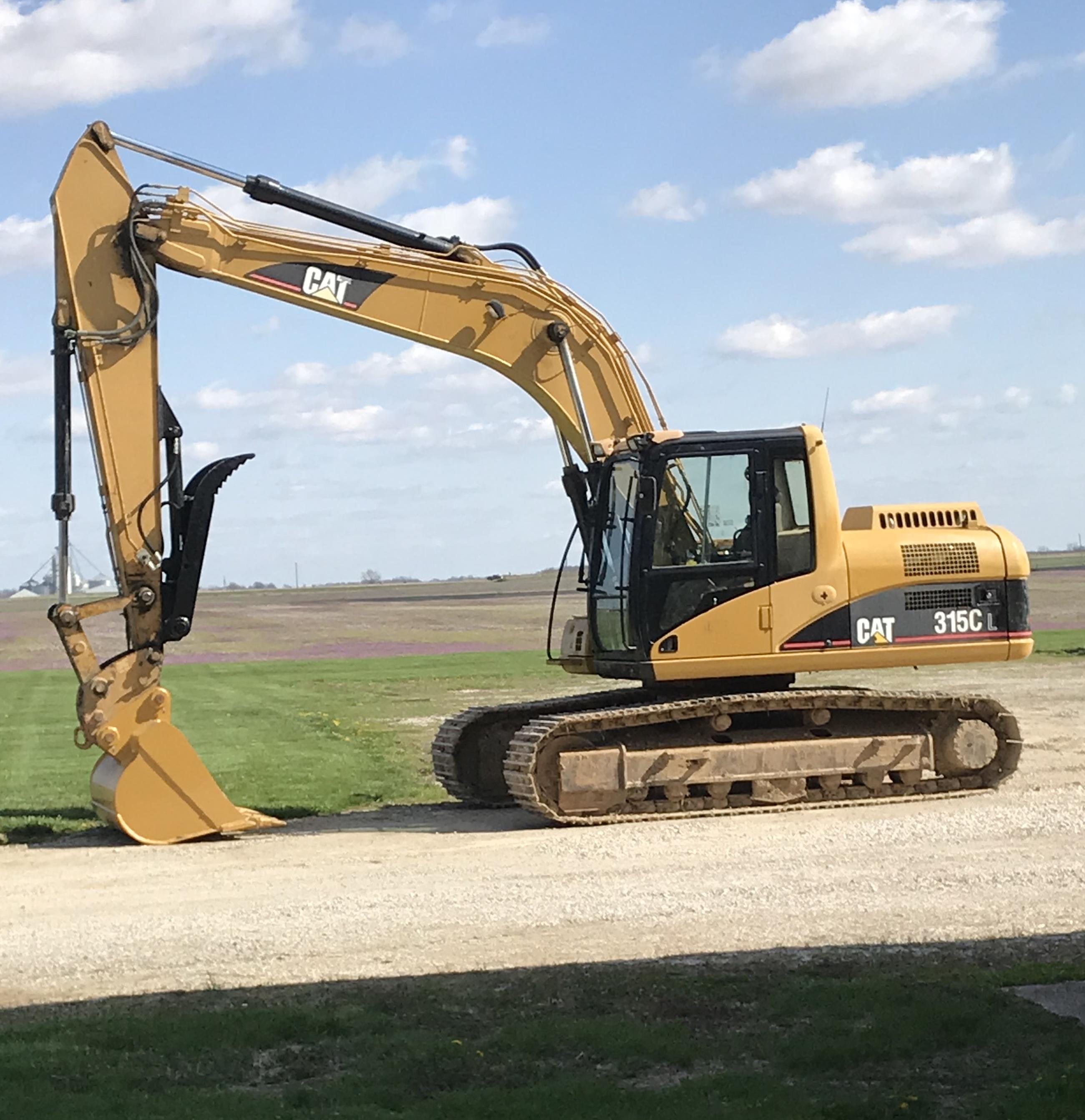 Stick mount excavator hydraulic thumb